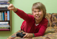 Boy   playing a video game console. Royalty Free Stock Image