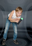 Boy playing a video game controller Royalty Free Stock Image