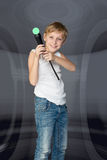 Boy playing a video game controller Stock Photography