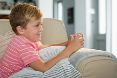 Boy playing video game in the living room. At home Stock Image