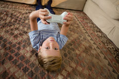 Boy playing video game in the living room. At home Royalty Free Stock Image