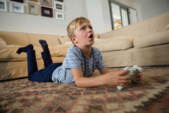Boy playing video game in the living room. At home Royalty Free Stock Photo