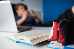 Boy Playing Video Game Instead Of Studying Stock Images