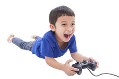 Boy playing video game Royalty Free Stock Images