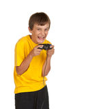 Boy playing video games. Isolated on white Stock Images