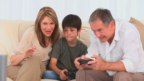 A boy playing video games stock footage