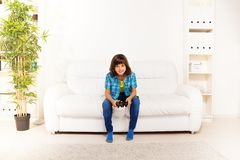 Boy playing videogame Stock Photography