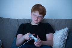 Boy Playing Videogames Royalty Free Stock Images