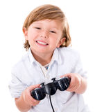 Boy playing videogames Royalty Free Stock Photography