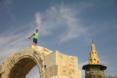 The boy is playing on the walls of Damascus. stock images