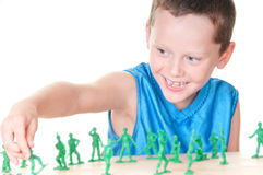 Boy playing war Stock Photography