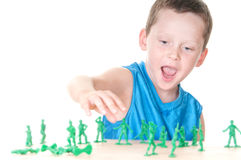 Boy playing war Stock Images