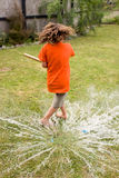 Boy playing with water balloon Royalty Free Stock Photos