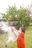 Boy playing with water balloon Royalty Free Stock Photography
