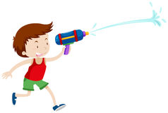 Boy playing with water gun Stock Photography