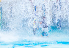 A boy playing with water park . Stock Image