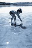 Boy playing in the water Stock Image
