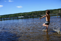 Boy playing in the water Royalty Free Stock Photos