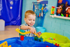 Boy playing water toy Stock Photography