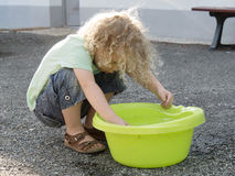Boy playing with water in the yard Royalty Free Stock Photo