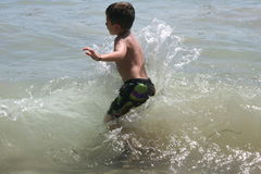 Boy Playing in Water Royalty Free Stock Image