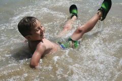 Boy Playing in Water Royalty Free Stock Photography