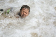 Boy Playing in Water Royalty Free Stock Images