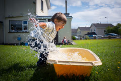 Boy playing with water Stock Image