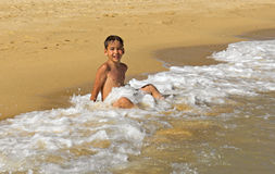 Boy playing in the waves Royalty Free Stock Photo