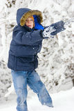 Boy playing in winter park Stock Photo