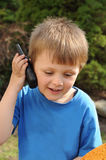 Boy playing with wireless station Stock Image