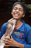 Boy Playing With Goat