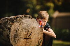 Free Boy Playing With Toy Gun In Playground Royalty Free Stock Photos - 140906598