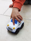Boy Playing With Toy Police Car Royalty Free Stock Images