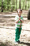 Boy is playing in the wood Stock Image