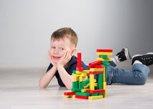 Boy playing with wooden cubes Stock Photos