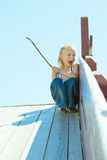 Boy playing on a wooden slide Stock Images