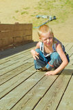Boy playing on a wooden slide Royalty Free Stock Photo