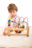 Boy playing with wooden toy Royalty Free Stock Photos