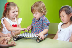 Boy playing xylophone Royalty Free Stock Photo
