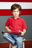Boy playing xylophone in music Stock Photo