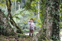 A boy playing in a tropical forest in Borneo Danum Valley reserve Stock Photos