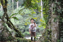 A boy playing in a tropical forest in Borneo Danum Valley reserve Stock Images