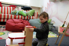 Boy in playroom Stock Images