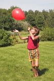 Boy plays with air-ball. In  solar day Royalty Free Stock Photos