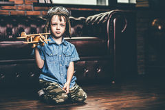 Boy plays with airplane Stock Images