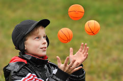 The boy plays with balls Stock Image