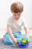 Boy plays with building kit Stock Photography