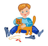 A boy plays with a cat Stock Images