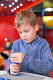 Boy plays with constructor in kindergarten Royalty Free Stock Images